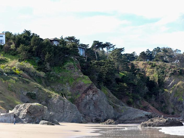 One of Dorsey's Sea Cliff homes is visible from the beach.