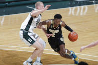 Purdue's Eric Hunter Jr., right, drives against Michigan State's Joey Hauser during the first half of an NCAA college basketball game Friday, Jan. 8, 2021, in East Lansing, Mich. (AP Photo/Al Goldis)