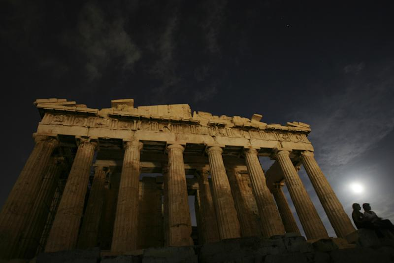 FILE - The moon shines on the ancient Parthenon temple on Acropolis hill in Athens on Wednesday, Aug. 9, 2006. Through the millennia, humans have asked: How did everything come into existence? Modern science's answer is the Big Bang Theory, which posits that the universe sprang in an instant from a sub-atomic fragment. The ancients, however, did not have $900 million machines to plumb the secrets of the universe. In the 4th century BC, the Greek philosopher Aristotle posited the world always existed, at the center of the universe. (AP Photo/Petros Giannakouris)