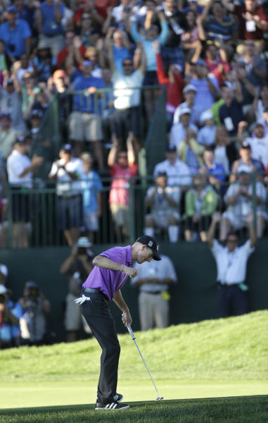 Jim Furyk celebrates after a birdie on the 18th hole during the third round of the PGA Championship golf tournament at Oak Hill Country Club, Saturday, Aug. 10, 2013, in Pittsford, N.Y. (AP Photo/Julio Cortez)