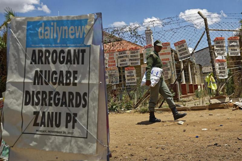 A news stand in Harare, Zimbabwe, shows headlines dominated by the country's political crisis. (AP)