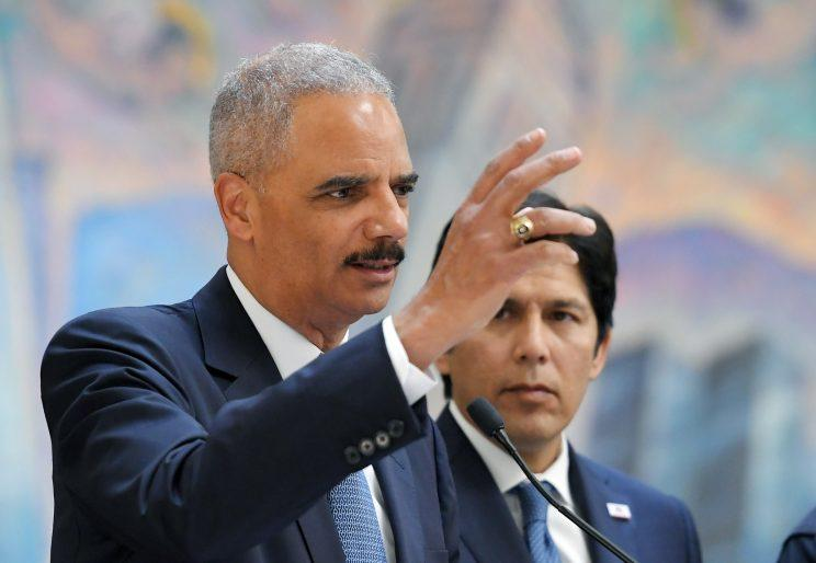 Former U.S. Attorney General Eric Holder, left, at a news conference with California state Senate President pro Tempore Kevin de Leon, Monday, June 19, 2017, in Los Angeles