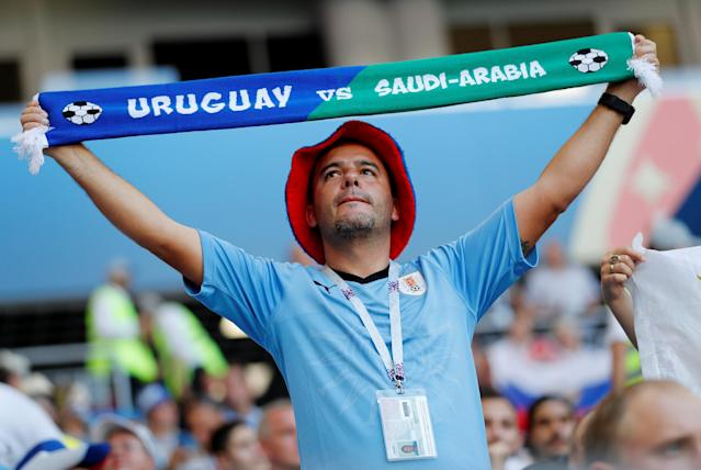 Soccer Football - World Cup - Group A - Uruguay vs Saudi Arabia - Rostov Arena, Rostov-on-Don, Russia - June 20, 2018 Uruguay fan with a half and half scarf inside the stadium before the match REUTERS/Carlos Garcia Rawlins
