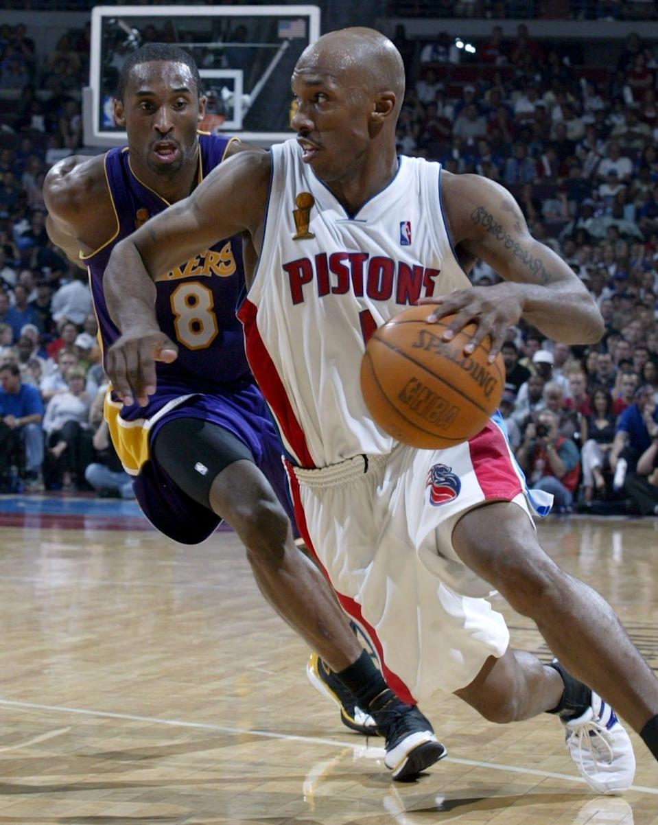 Detroit Pistons' Chauncey Billups drives past the defense of Los Angeles Lakers' Kobe Bryant during the third quarter in Game 4 of the NBA Finals, Sunday, June 13, 2004, at the Palace of Auburn Hills.