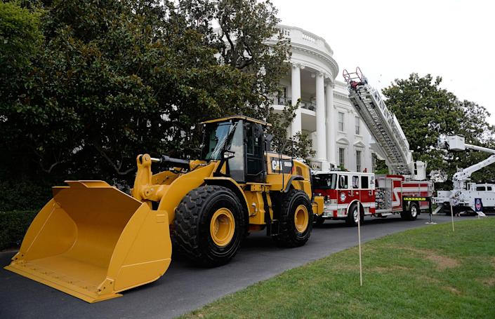"""<p>U.S.-made products from all 50 states, including an iconic Yellow Iron from Caterpillar Inc., are on display on the South Lawn of the White House as part of a """"Made in America"""" product showcase event in Washington, D.C. on July 17, 2017. (Olivier Douliery/AFP/Getty Images) </p>"""
