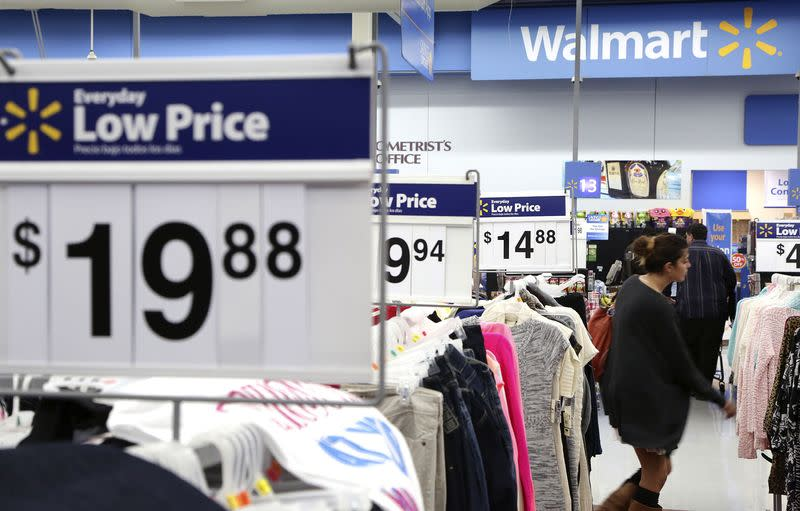 A woman shops at Walmart as the store prepares for Black Friday in Los Angeles