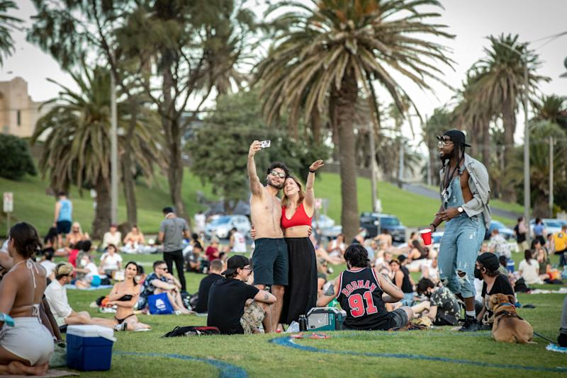 Melbourne residents flocked outside to parks and beaches to soak up the sun, prompting a warning from Daniel Andrews.
