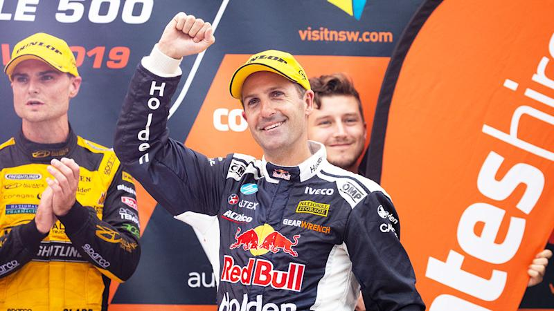 Pictured here, Holden driver Jamie Whincup salutes Supercars fans.