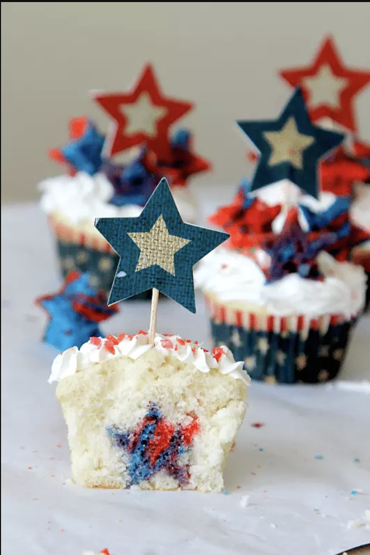 """<p>Bite into these star-spangled cupcakes and you get not one, but <em>two</em> surprises: a sweet star-shaped filling inside, plus some pop rocks that add a """"firecracker"""" snap!</p><p><em><a href=""""https://www.momdot.com/firecracker-surprise-inside-cupcakes/"""" rel=""""nofollow noopener"""" target=""""_blank"""" data-ylk=""""slk:Get the recipe from MomDot »"""" class=""""link rapid-noclick-resp"""">Get the recipe from MomDot »</a></em> </p>"""