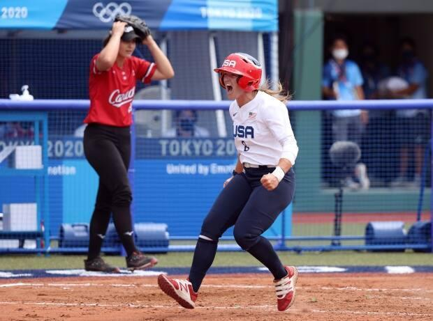 Canadian pitcher Jenna Caira, left, reacts after the U.S. scores during her team's 1-0 loss on Wednesday in the opening round of the 2020 Tokyo Olympic Games. (Yuichi Masuda/Getty Images - image credit)