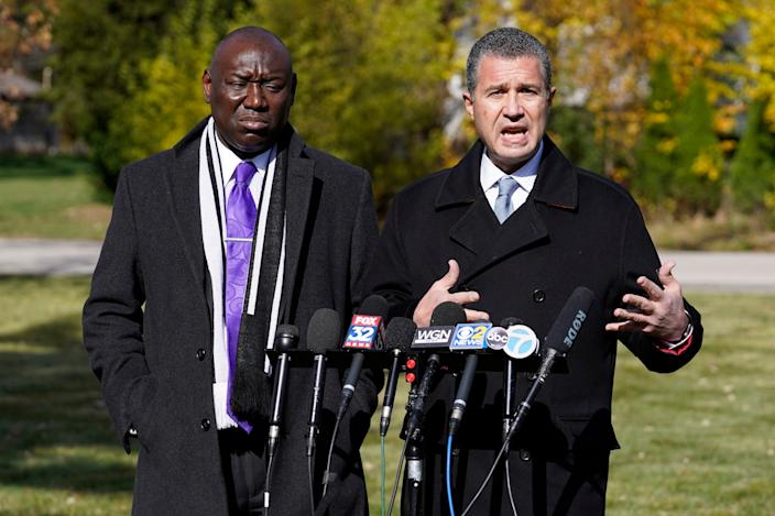Attorney Antonio Romanucci, right, speaks as attorney Ben Crump listens during a press conference , Wednesday, Oct. 28, 2020, in Des Plaines, Ill.
