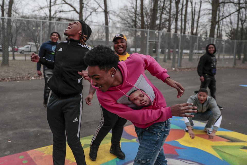 Taevion Rushing, left, plays pickup basketball with Taras Rushing, front, and other members of his family.