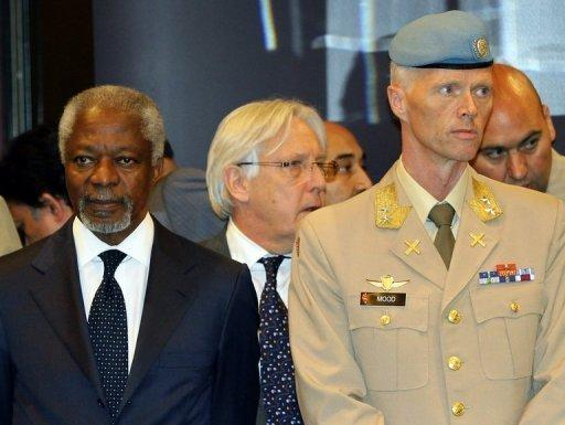 UN-Arab League peace envoy Kofi Annan (L) stands next to UN mission chief in Syria, Major General Robert Mood, ahead of a press conference in Damascus on May 29. China on Wednesday restated its opposition to military intervention in Syria, as Russia sought to halt fresh UN Security Council action after a massacre of civilians sparked global fury