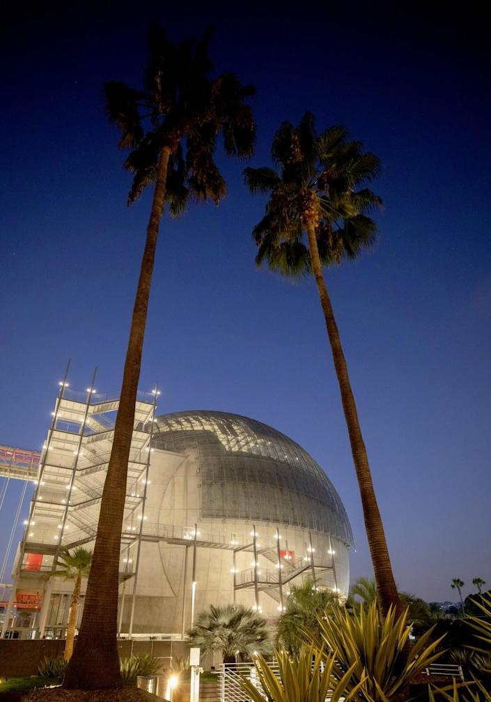 The Academy of Motion Pictures Museum at night.