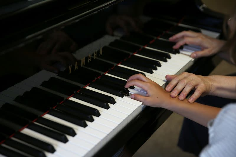 Stelios Kerasidis, 7-year-old pianist and composer, plays the piano during a lesson at the Athens Megaron Concert Hall in Athens