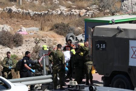 Body is carried at the scene of what Israeli military said is a car-ramming attack near the https://www.reutersconnect.com/detail?id=tag%3Areuters.com%2C2019%3Anewsml_LYNXNPEF7F116%3A1settlement of Elazar in the Israeli-occupied West Bank