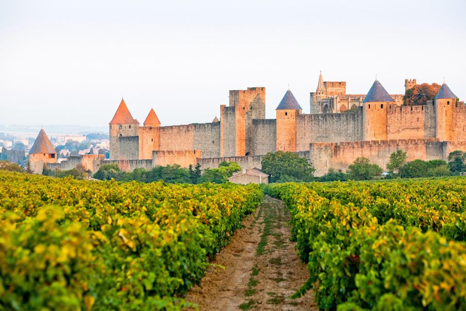 """<p><strong>Population:</strong> 45,996</p> <p>The Languedoc region is <a href=""""https://www.cntraveler.com/story/why-languedoc-is-like-nowhere-else-in-france?mbid=synd_yahoo_rss"""" rel=""""nofollow noopener"""" target=""""_blank"""" data-ylk=""""slk:like nowhere else in France"""" class=""""link rapid-noclick-resp"""">like nowhere else in France</a>, thanks to its sun-baked beaches, forested peaks, and density of vineyards. It's perhaps best exemplified by the medieval town of Carcassonne. Overlooking the river Aude, the town's main lure is La Cité, a 10th-century citadel complete with ramparts and a drawbridge.</p>"""