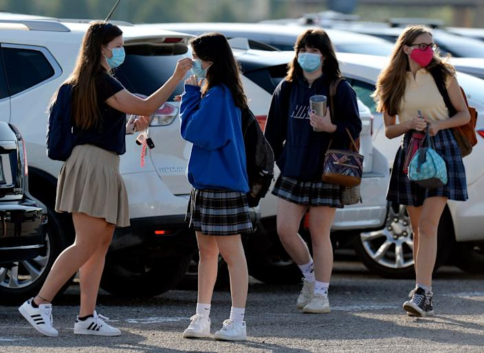 Merrol Hyde Magnet School students arrive for the first day of school on Aug. 3, 2020, in Hendersonville, Tenn. Sumner County was the first school district in Middle Tennessee district to go back to in-person classes during the COVID-19 pandemic.