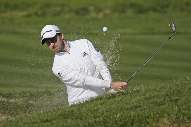 Nick Taylor, of Canada, hits out of a bunker up to the second green of the Pebble Beach Golf Links during the final round of the AT&T Pebble Beach National Pro-Am golf tournament Sunday, Feb. 9, 2020, in Pebble Beach, Calif. (AP Photo/Eric Risberg)