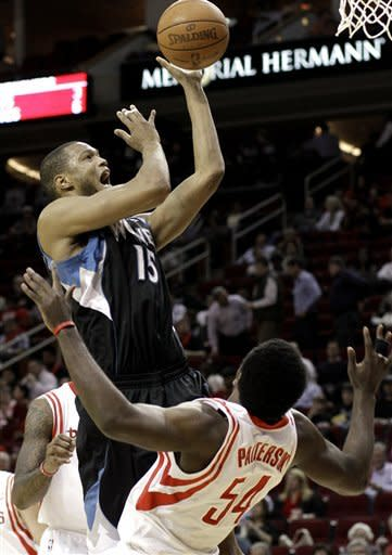 Minnesota Timberwolves' Anthony Randolph (15) shots while fouled by Houston Rockets' Patrick Patterson (54) in the first half of an NBA basketball game, Monday, Jan. 30, 2012, in Houston. (AP Photo/Pat Sullivan)