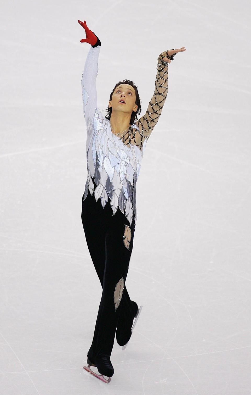 Johnny Weir at the 2006 Olympics wearing a swan costume with a red glove on one hand