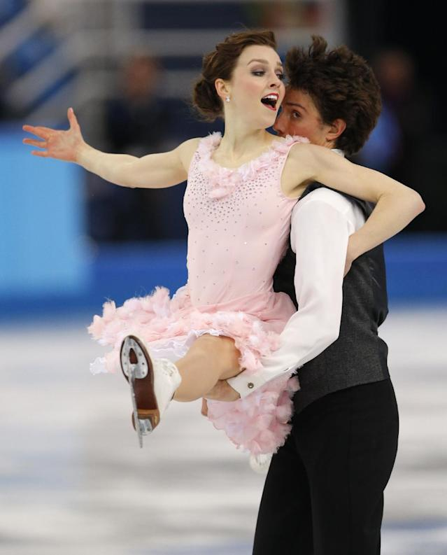 Alexandra Paul and Mitchell Islam of Canada compete in the ice dance short dance figure skating competition at the Iceberg Skating Palace during the 2014 Winter Olympics, Sunday, Feb. 16, 2014, in Sochi, Russia