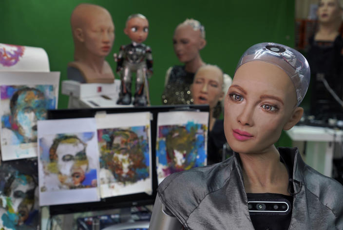 Sophia answers questions at Hanson Robotics studio in Hong Kong on March 29, 2021. Sophia is a robot of many talents — she speaks, jokes, sings and even makes art. In March, she caused a stir in the art world when a digital work she created as part of a collaboration was sold at an auction for $688,888 in the form of a non-fungible token (NFT). (AP Photo/Vincent Yu)