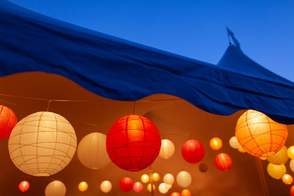 Event tent in the evening with bright paper lanterns