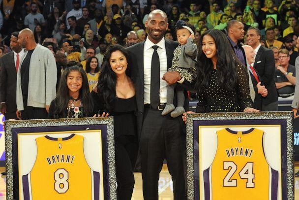 PHOTO: Kobe Bryant, wife Vanessa Bryant and daughters Gianna Maria Onore Bryant, Natalia Diamante Bryant and Bianka Bella Bryant attend Kobe Bryant's jersey retirement ceremony during a game between at Staples Center on Dec. 18, 2017, in Los Angeles. (Allen Berezovsky/Getty Images)