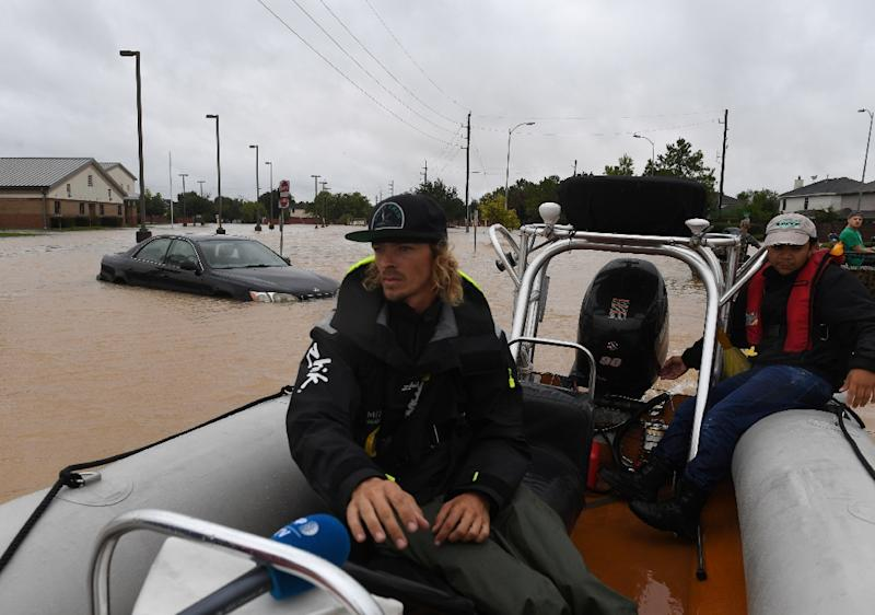 Andrew Brennan from Louisiana heads to a rescue as he helps evacuate the Clodine district after Hurricane Harvey caused heavy flooding in Houston (AFP Photo/MARK RALSTON)
