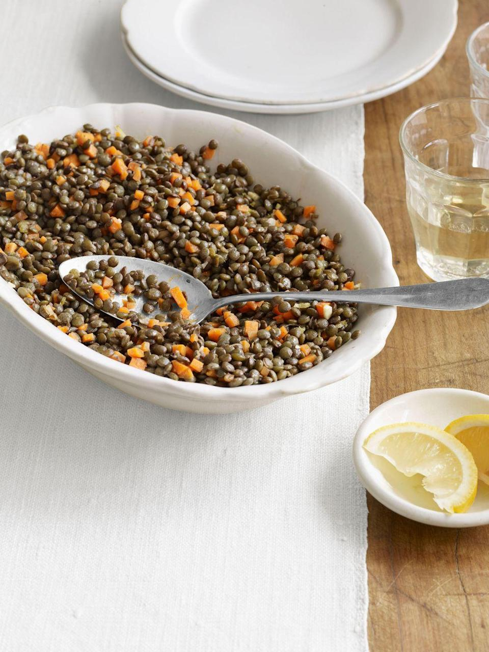 "When many people think of French cuisine, they think of complicated plates covered in lots of butter, cheese, and other fatty foods. But much traditional French food, like this lentil recipe, is light, healthy, and incredibly simple. <a href=""https://www.countryliving.com/food-drinks/recipes/a3648/french-lentil-salad-recipe-clx0411/"" rel=""nofollow noopener"" target=""_blank"" data-ylk=""slk:Get the recipe."" class=""link rapid-noclick-resp""><strong>Get the recipe.</strong></a>"