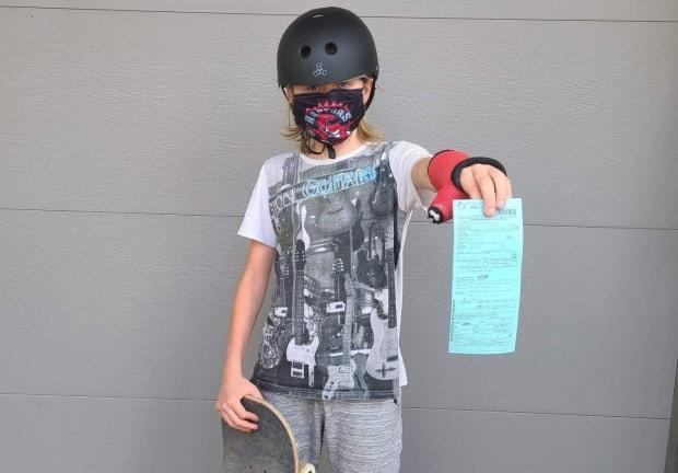 Merrick Batstone, 14, shows the $880 ticket handed to his family days after he visited Legacy Skatepark. (Submitted by Michelle Opthof - image credit)