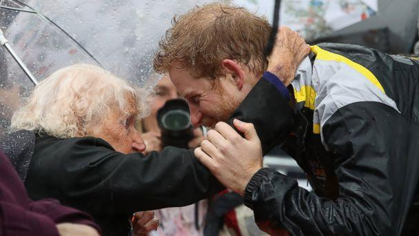 PHOTO: Prince Harry hugs Daphne Dunne at the Overseas Passenger Terminal, June 7, 2017 in Sydney. (Chris Jackson/Getty Images)