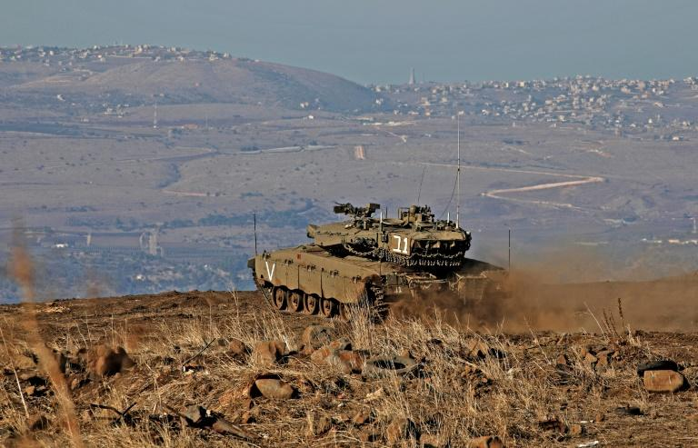 An Israeli armoured vehicle watches over Syrian government-held territory from the annexed Golan Heights (AFP Photo/JALAA MAREY)