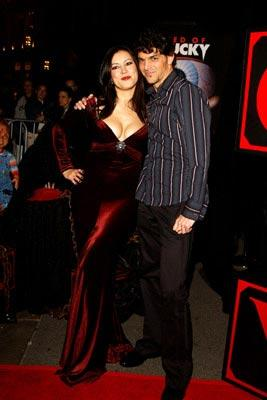 "Premiere: <a href=""/movie/contributor/1800018758"">Jennifer Tilly</a> and director <a href=""/movie/contributor/1800020775"">Don Mancini</a> at the Los Angeles premiere of Rogue Pictures' <a href=""/movie/1808405790/info"">Seed of Chucky</a> - 11/10/2004<br>Photo: <a href=""http://www.wireimage.com/"">Amy Graves, WireImage.com</a>"