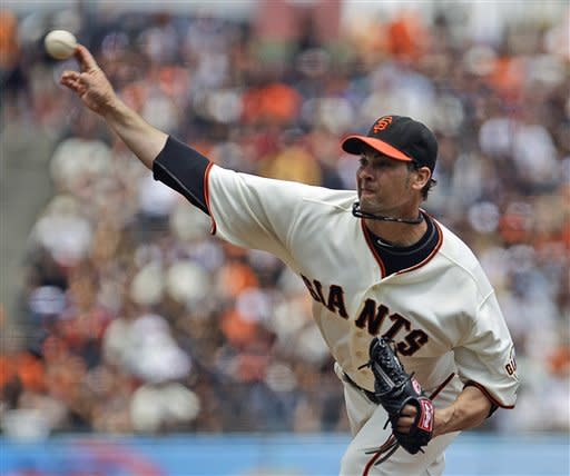 San Francisco Giants' Ryan Vogelsong works against the Cincinnati Reds in the first inning of a baseball game, Sunday, July 1, 2012, in San Francisco. (AP Photo/Ben Margot)