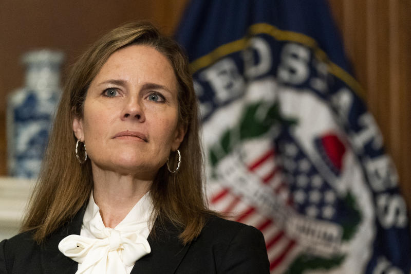 FILE - In this Oct. 1, 2020, file photo President Donald Trump's Supreme Court nominee Judge Amy Coney Barrett listens as Sen. Jerry Moran, R-Kan., not shown, speaks during their meeting on Capitol Hill in Washington. Democrats are treading carefully on religious faith as they prepare to question President Donald Trump's Supreme Court nominee. (AP Photo/Manuel Balce Ceneta, Pool)