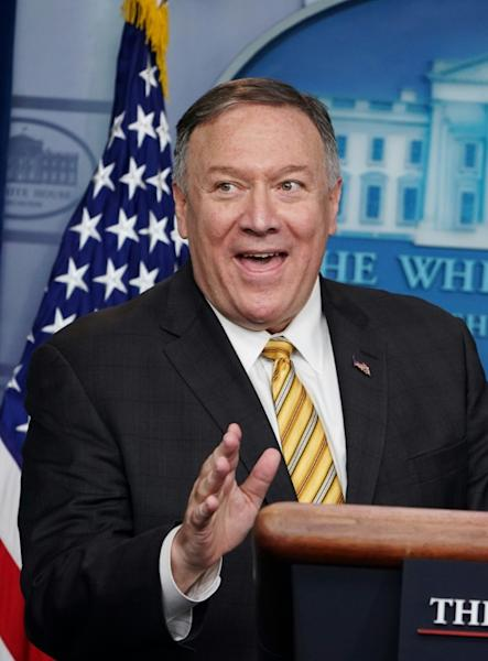 A smiling Secretary of State Mike Pompeo addresses reporters after the departure of national security advisor John Bolton