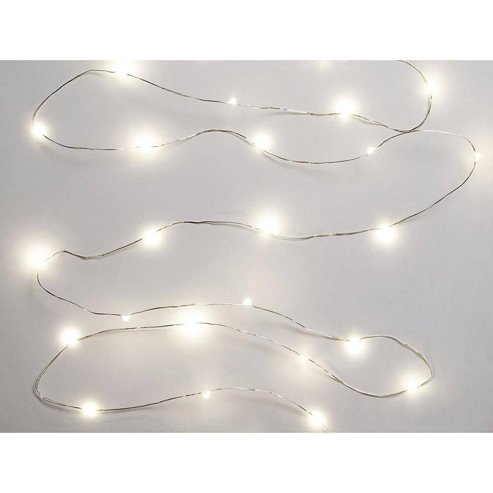 """<p><a href=""""https://www.popsugar.com/buy/LED-Twinkle-Lights-531086?p_name=LED%20Twinkle%20Lights&retailer=papersource.com&pid=531086&price=13&evar1=casa%3Aus&evar9=47010437&evar98=https%3A%2F%2Fwww.popsugar.com%2Fhome%2Fphoto-gallery%2F47010437%2Fimage%2F47011007%2FLED-Twinkle-Lights&list1=holiday%2Cchristmas%2Cchristmas%20decorations%2Ccactus%2Cchristmas%20trees%2Choliday%20decor%2Csmall%20space%20living%2Cpersonal%20essay&prop13=api&pdata=1"""" rel=""""nofollow"""" data-shoppable-link=""""1"""" target=""""_blank"""" class=""""ga-track"""" data-ga-category=""""Related"""" data-ga-label=""""https://www.papersource.com/party/led-twinkle-lights-520557.html"""" data-ga-action=""""In-Line Links"""">LED Twinkle Lights</a> ($13)</p>"""