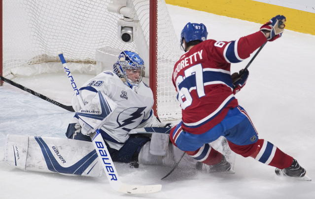 Tampa Bay Lightning goaltender Andrei Vasilevskiy (88) makes a save against Montreal Canadiens left wing Max Pacioretty (67) during second-period NHL hockey game action in Montreal, Saturday, Feb. 24, 2018. (Graham Hughes/The Canadian Press via AP)