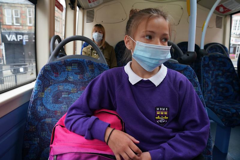 (Permission granted) A school pupil wearing a face mask on a bus in Newcastle as face coverings become mandatory on public transport in England with the easing of further lockdown restrictions during the coronavirus pandemic. (Photo by Owen Humphreys/PA Images via Getty Images)