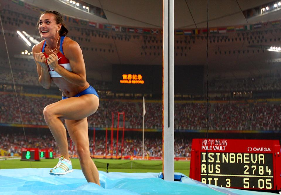 BEIJING - AUGUST 18: Elena Isinbaeva of Russia celebrates successfully jumping a new World Record of 5.05 in the Women's Pole Vault Final at the National Stadium on Day 10 of the Beijing 2008 Olympic Games on August 18, 2008 in Beijing, China. (Photo by Michael Steele/Getty Images)