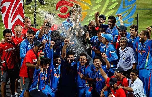MUMBAI, INDIA - APRIL 02: India players Yuvraj Singh, Virat Kohli and Dr Nitin Patel (R) celebrate with the trophy after India defeated Sri Lanka a in the 2011 ICC World Cup Final between India and Sri Lanka played at Wankhede Stadium on April 2, 2011 in Mumbai, India. (Photo by Graham Crouch/Getty Images)