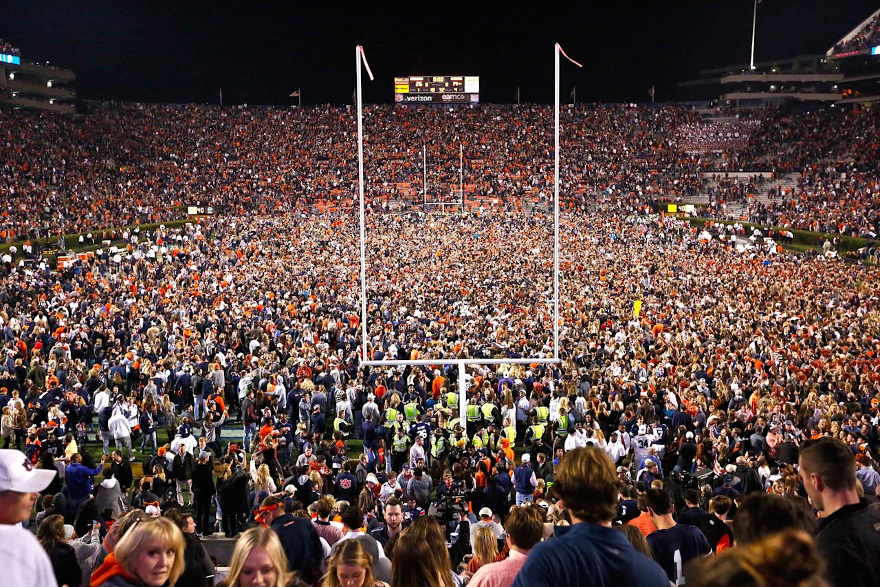 <p>Fans rush the field after Auburn defeated Alabama in the Iron Bowl NCAA college football game, Saturday, Nov. 25, 2017, in Auburn, Ala. (AP Photo/Brynn Anderson) </p>