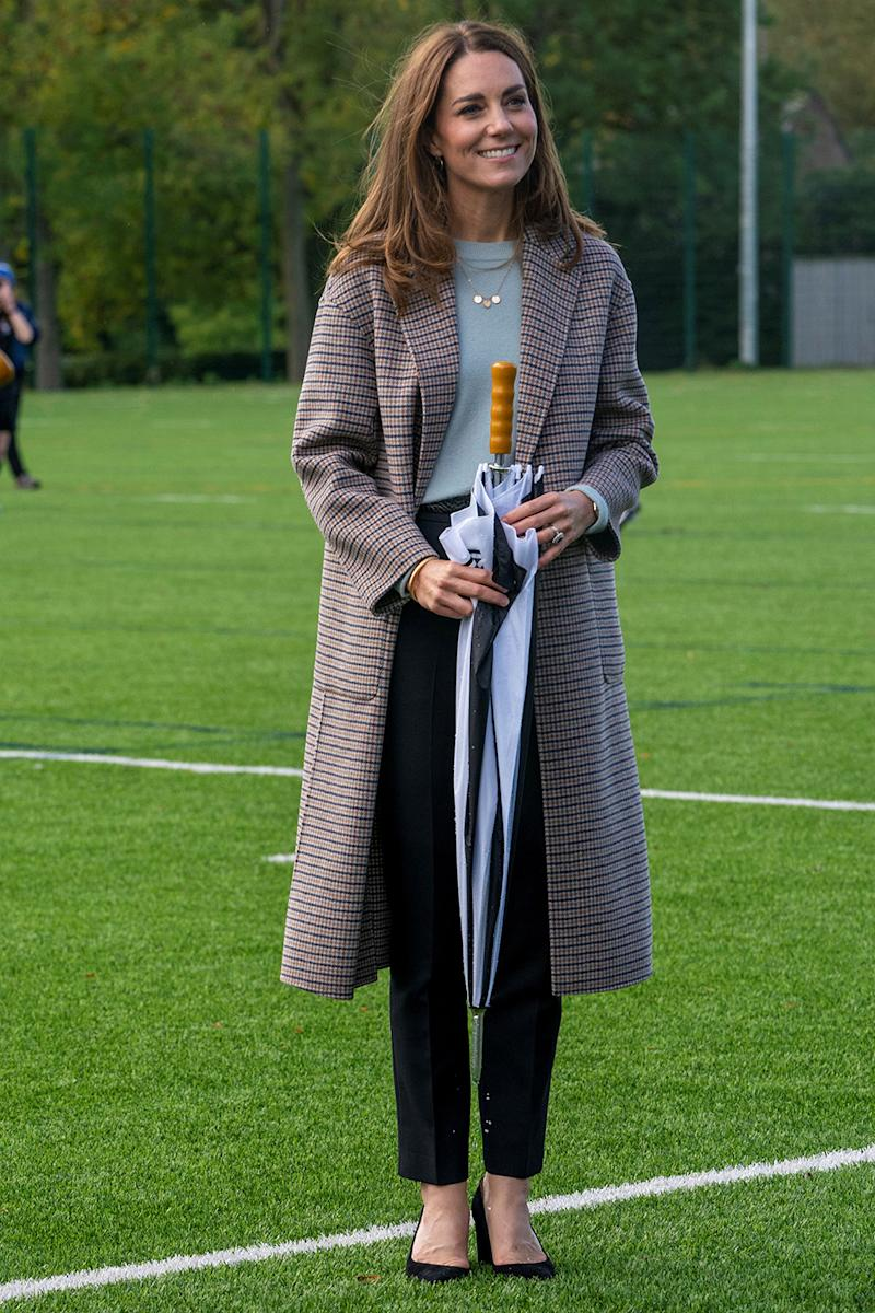 The Duchess of Cambridge arrived to the University of Derby wearing a checkered wool coat by Massimo Dutti. Image via Getty Images.