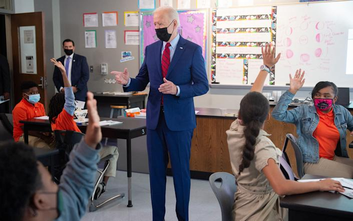 US President Joe Biden speaks with students in a 6th grade science class during a visit to speak about coronavirus protections in schools at Brookland Middle School in Washington, DC, September 10, 2021. (Photo by SAUL LOEB / AFP) (Photo by SAUL LOEB/AFP via Getty Images)