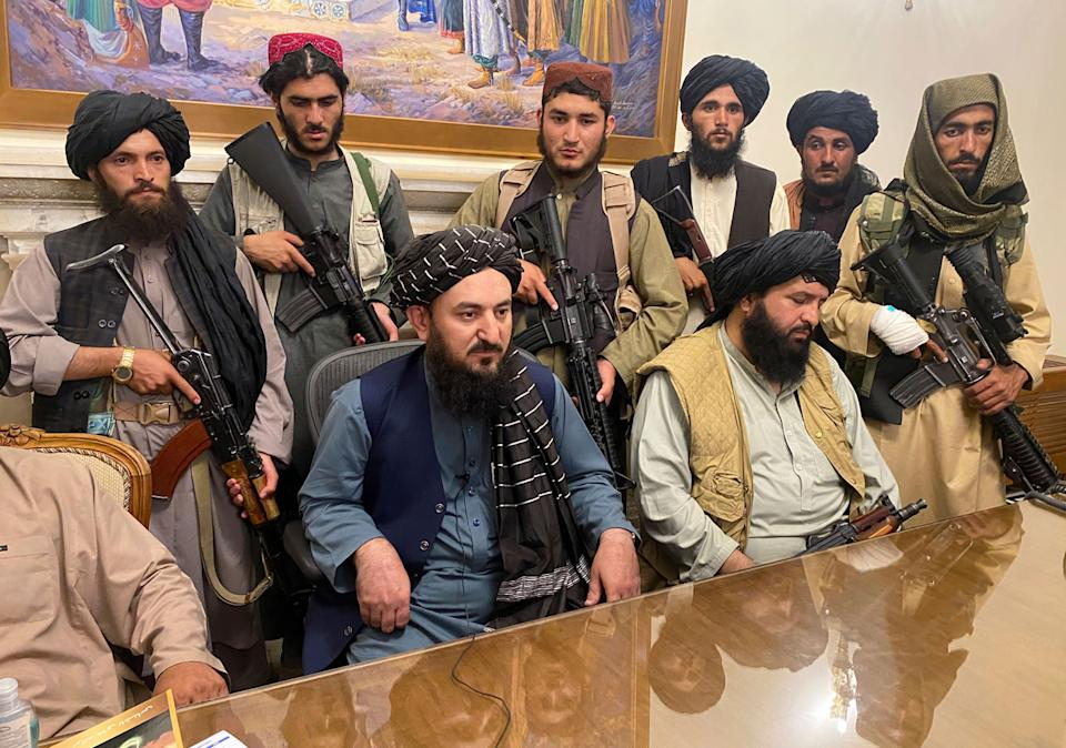 Taliban fighters take control of Afghan presidential palace after the Afghan President Ashraf Ghani fled the country, in Kabul, Afghanistan. Source: AP