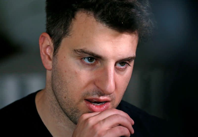 FILE PHOTO: FILE PHOTO: Co-founder and CEO of Airbnb Brian Chesky speaks during an interview in Langa township, Cape Town