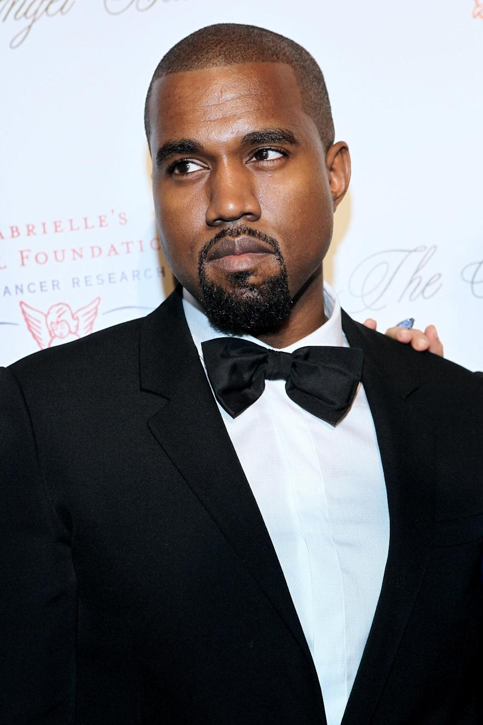 <p>These days, it's harder to catch Kanye West smiling—but you can always count on him to dress sharp. <i>(Photo: Getty Images)</i></p>