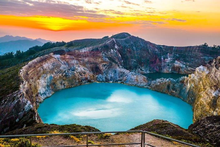 <p>A turquoise-colored crater lake sits in Mount Kelimutu volcano on Flores Island in Indonesia.</p>